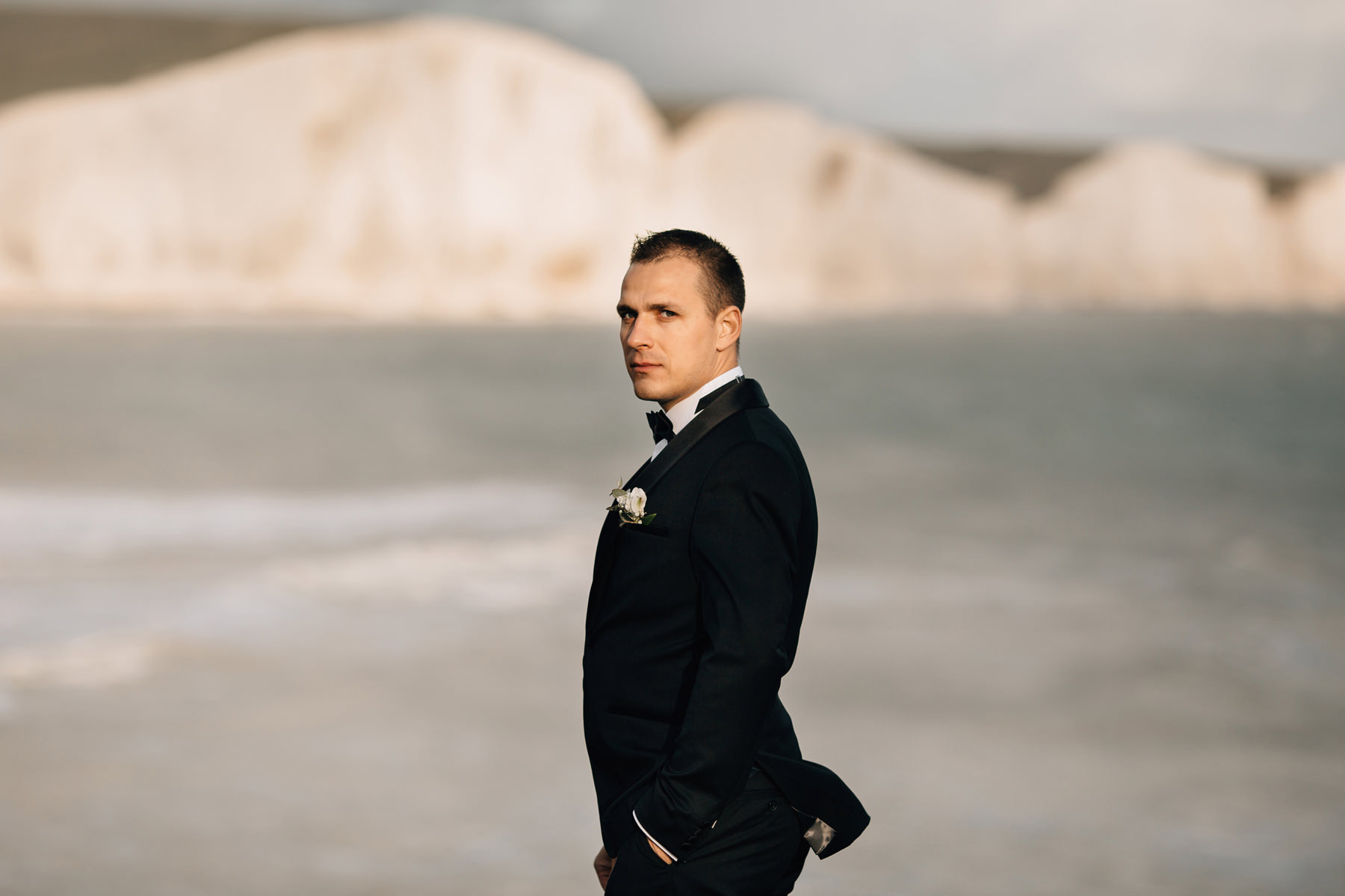groom portrait at seven sisters cliffs