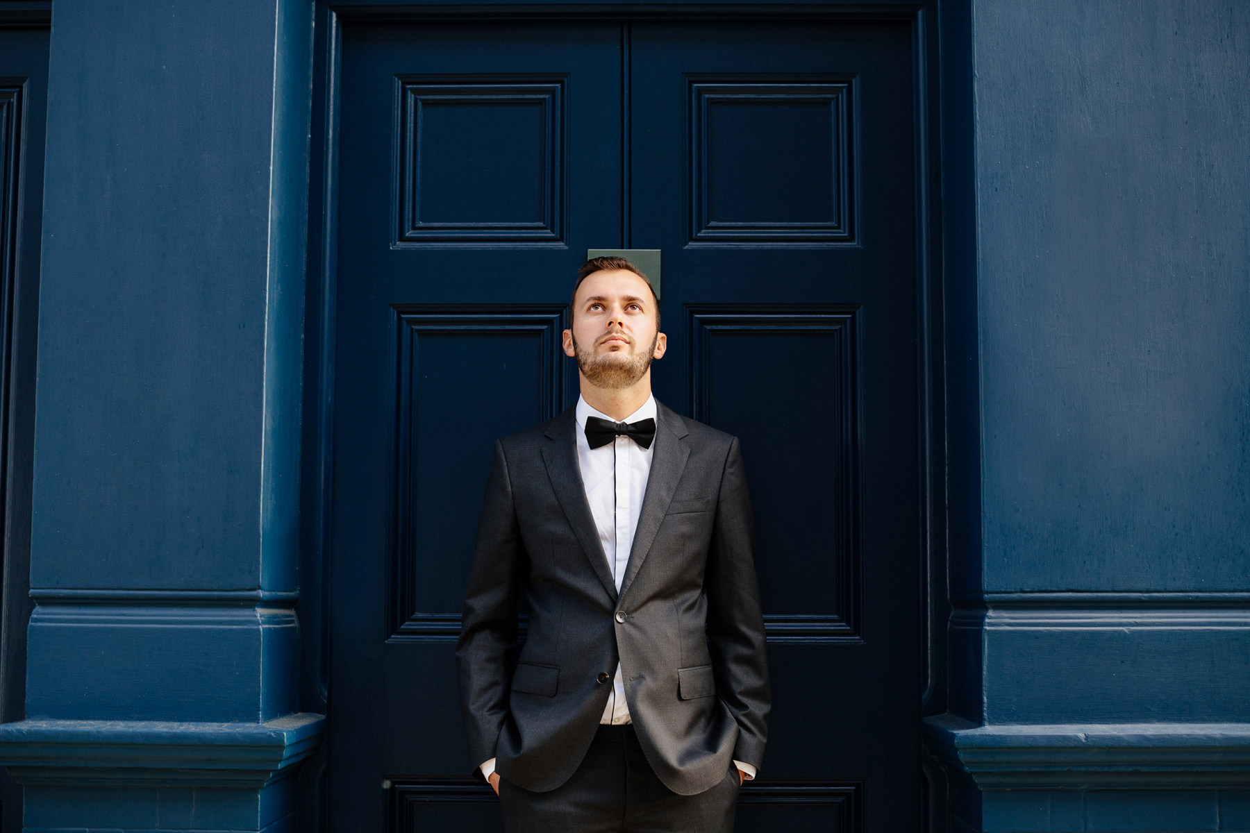 notting hill groom portrait at door